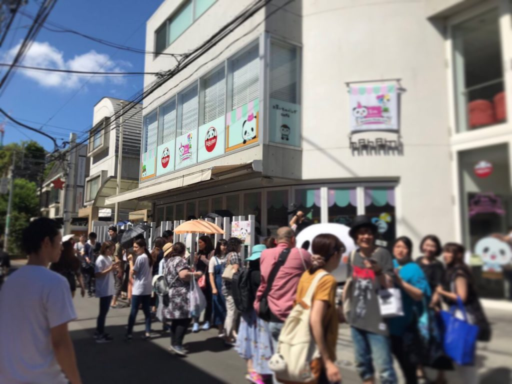 Ahead of opening, shoppers in Omotesando were queuing to take selfies with the Okaimono Panda on the street.