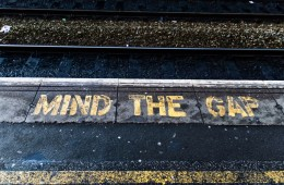 Train platform edge. Painted warning on the floor.