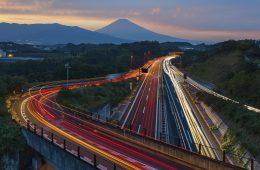 Tech Revolution in Tokyo: Japan highway long exposure and Mountain Fuji in autumn season evening