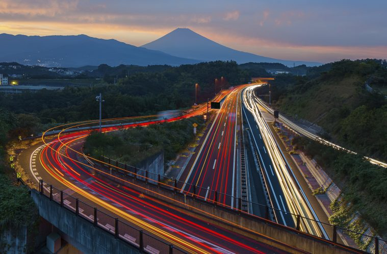Tech Revolution in Tokyo: Japan highway long exposure and Mountain Fuji in autumn season evening