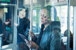 Woman using Kobo eReader on train