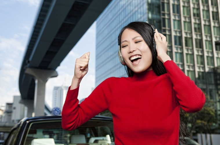 Japanese woman singing. Can karaoke help if you want to study English in Japan?