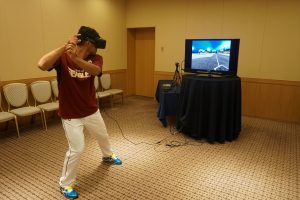 Rakuten Eagles player Toshiaki Imae tries out the virtual reality Baseball batting coaching system