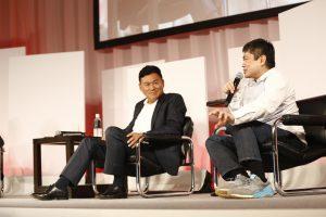 Hiroshi Mikitani, Joi Ito on stage at Rakuten FinTech Conference 2016