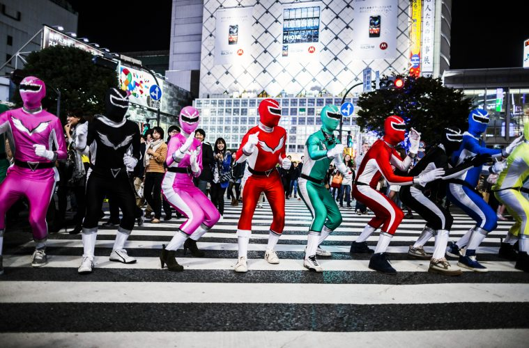 Halloween cosplayers pose on the Shibuya Scramble Crossing in Tokyo