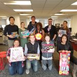 Members of the Rakuten Marketing team in New York with some of the presents collected on the toy drive
