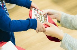 A Rakuten employee gives a present to a child