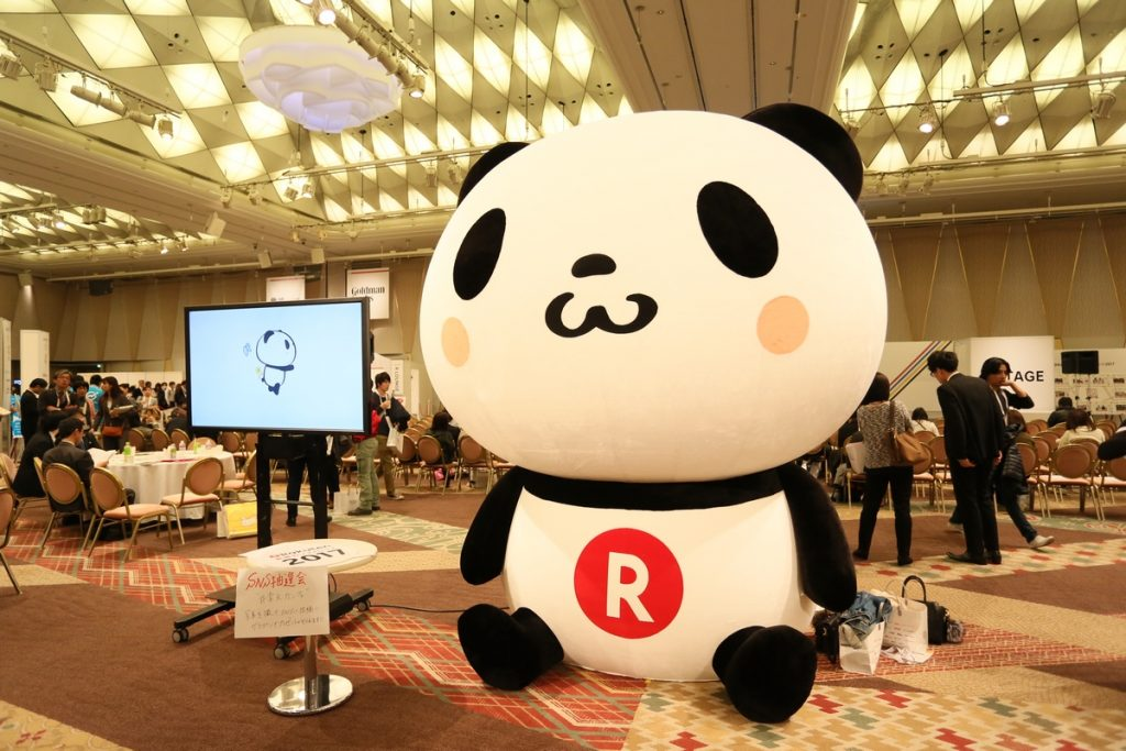 The enormous Rakuten Panda mascot dwarfed everyone and everything in the hall.