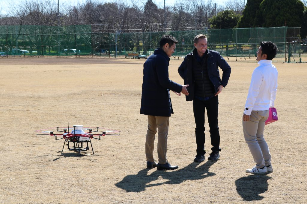 Ripley jokes with members of the Rakuten drone team.