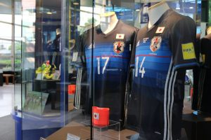 Japan's national football squad shirts on display at the museum.