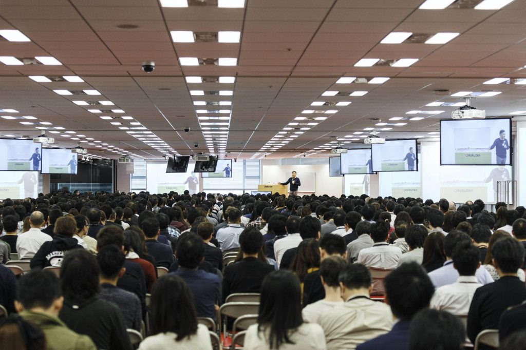 The Asakai venue seats around 2,000 employees. Thousands more tune into the weekly meeting from their desks via a videoconference system.