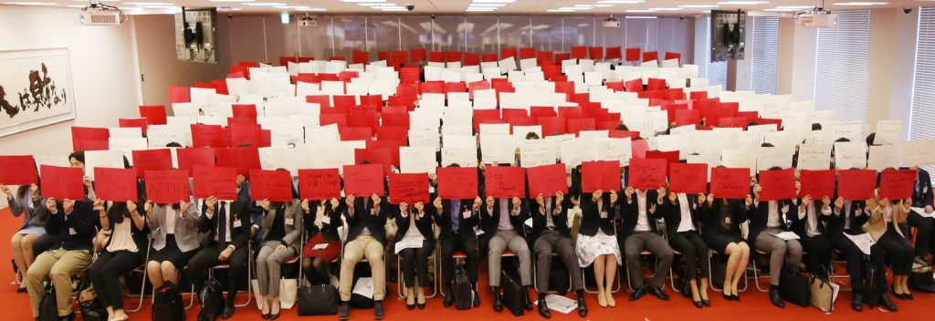 "The new graduates wrote their goals on colored paper, and coordinated at the ceremony to spell the letters ""R20,"" celebrating Rakuten's 20 years of business."