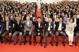 "Rakuten Chairman & CEO Hiroshi ""Mickey"" Mikitani (center) and other executives pose with the 360 fresh hires."