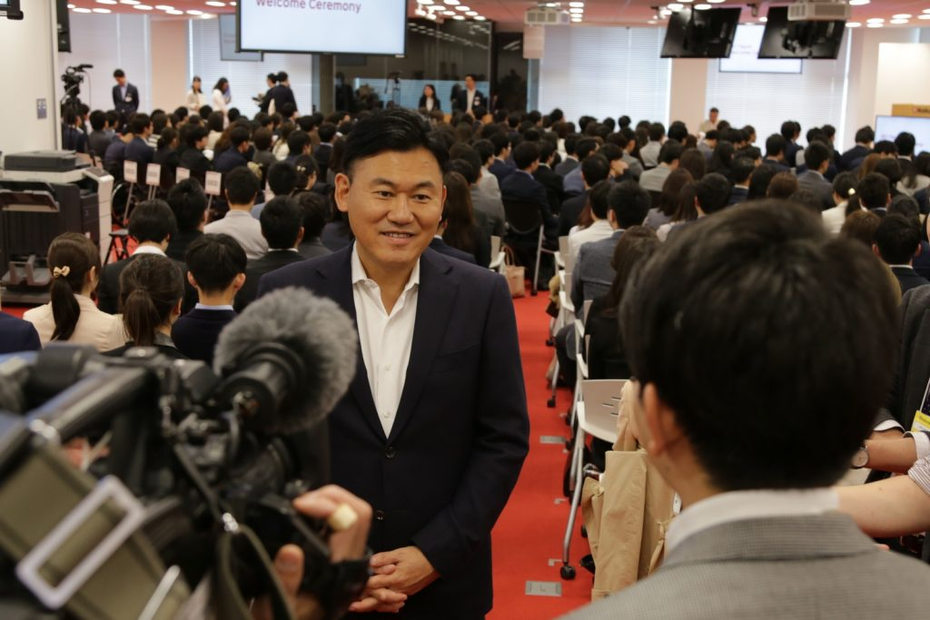 The beginning of the financial year (April 1) is also the traditional season for welcoming new university graduates to Japanese corporate life, and local media come out to cover the day's events.