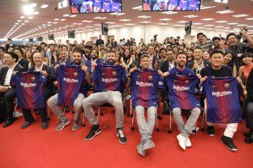 Turan, Pique, Neymar and Messi pose with Rakuten employees in Tokyo