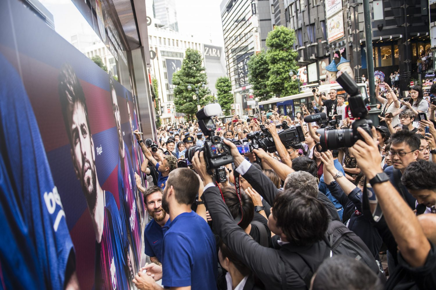 Messi and team draw crowds at surprise signing of Barca-themed cafe in Tokyo