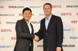 "Rakuten CEO Hiroshi ""Mickey"" Mikitani and Walmart CEO Doug McMillon shaking hands at a press conference announcing the formation of a strategic alliance between Rakuten and Walmart in Tokyo, Japan."