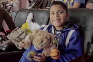 A group of young Golden State Warriors fans and their families were treated to a very special Christmas gift last month in Oakland, California.