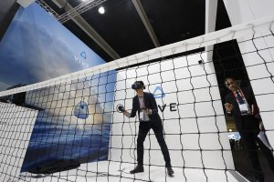 the Vive booth two men wearing headsets played a vigorous game of table tennis without a table.