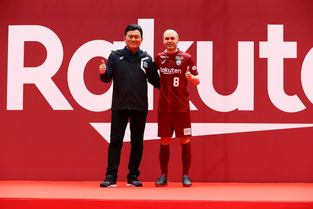 "After a rousing rendition of Vissel Kobe's anthem, Iniesta stepped on to the pitch where he joined Rakuten CEO Hiroshi ""Mickey"" Mikitani on stage."