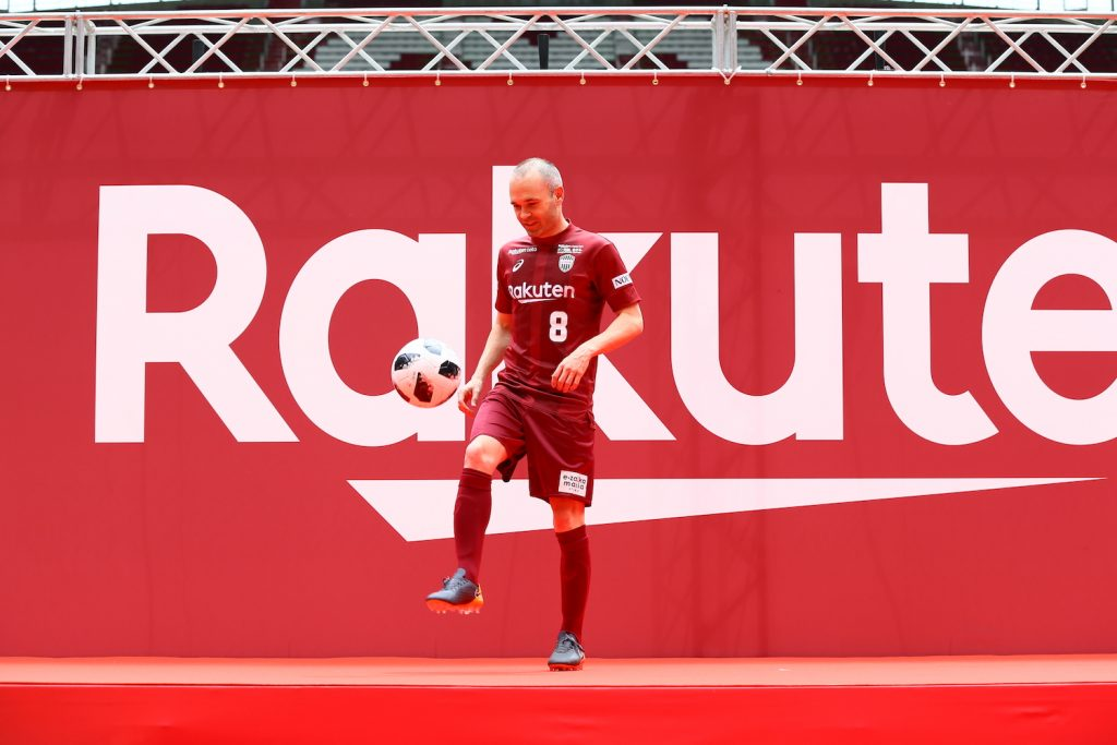 During the unveiling ceremony a relaxed and smiling Iniesta wearing his new No. 8 shirt showed off some of his famous ball skills while the crowd cheered him on.