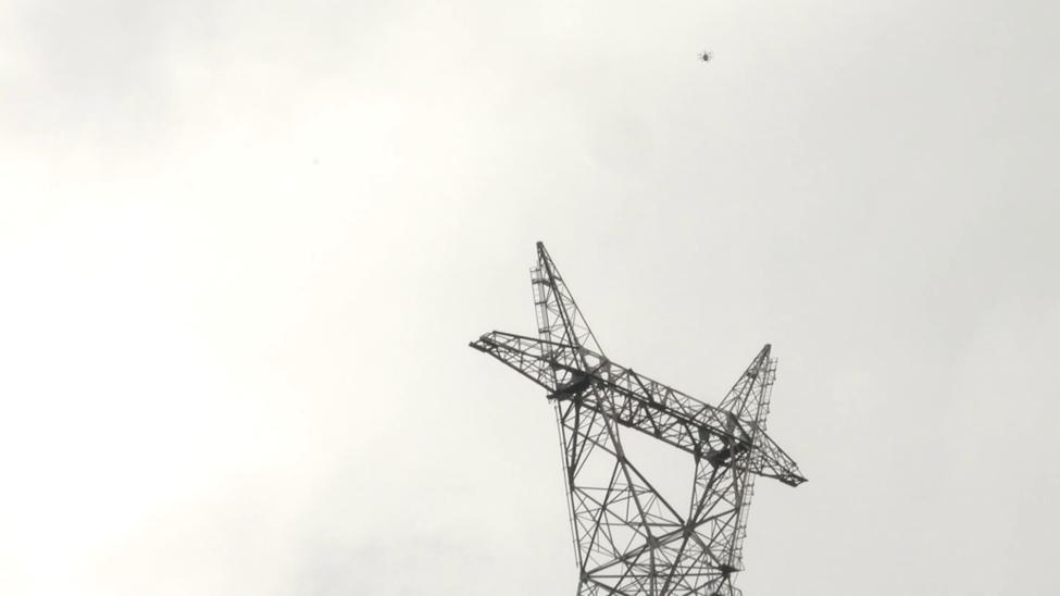 Rakuten's drone flying above a TEPCO tower in Chichibu, Saitama.