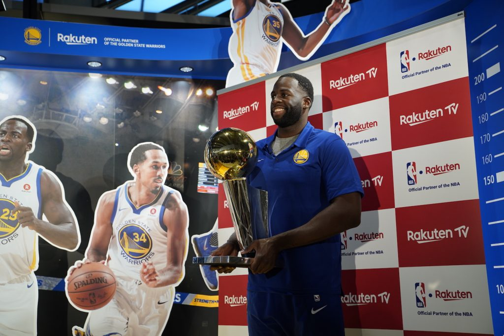 Draymond Green poses for media with the 2018 NBA Championship Trophy.