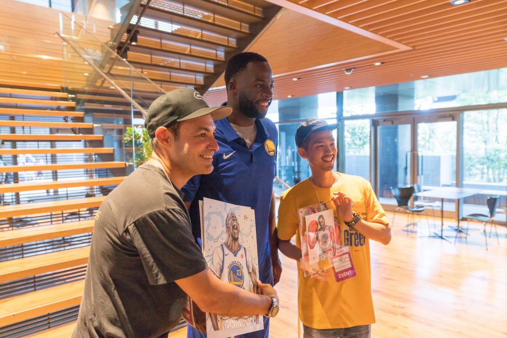 World Renowned caricature artists Dai Tamura (right) presenting Draymond Green with his portrait.