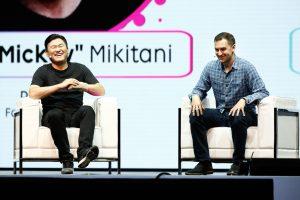 "Rakuten CEO Hiroshi ""Mickey"" Mikitani sharing a laugh with Lyft President and Co-founder John Zimmer."