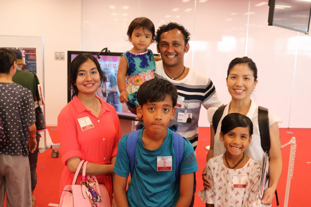Rosa (center back) brought the whole family to experience life at the Rakuten office.