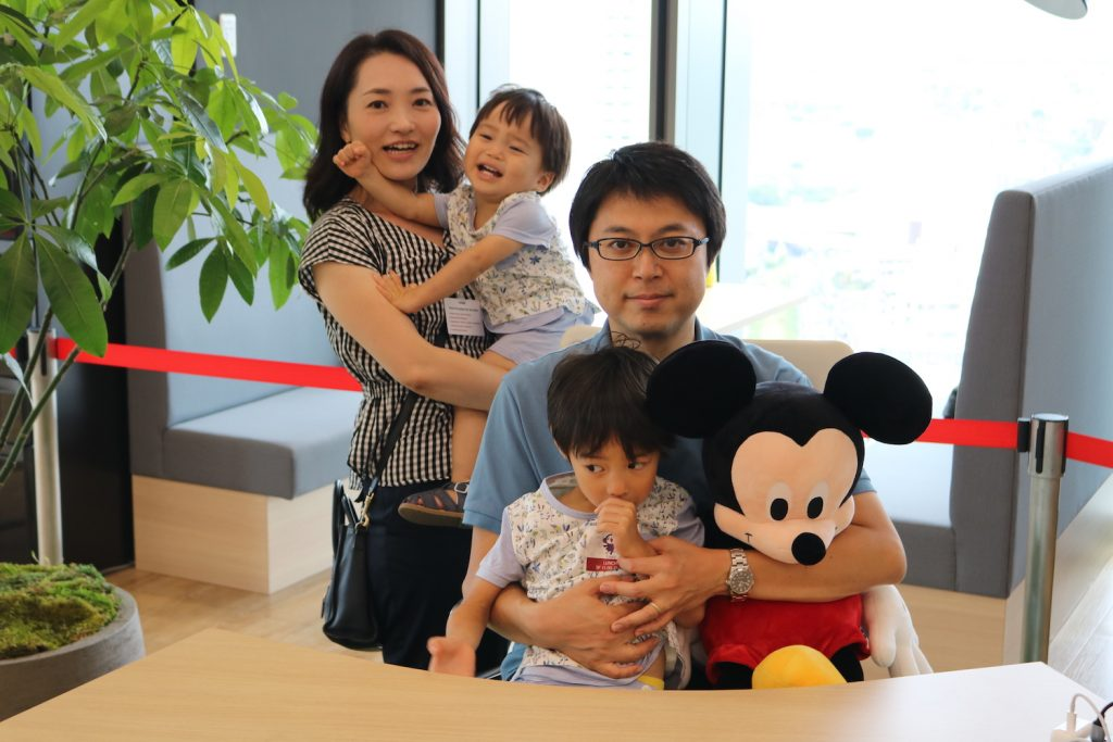 "Yukie (left) and family pose with ""Mickey"""