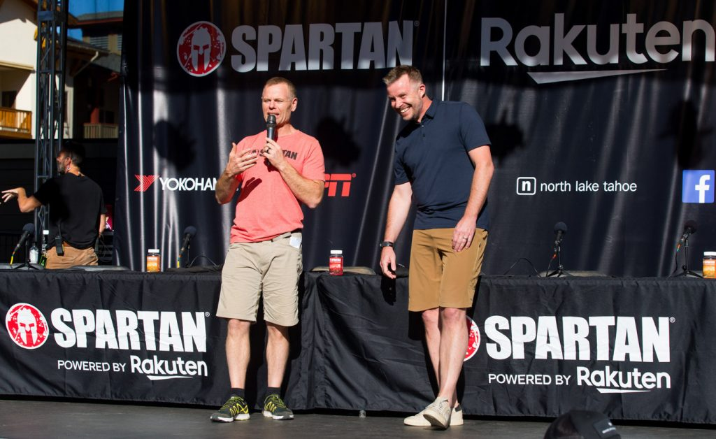 Spartan Founder & CEO Joe De Sena (left) and Rakuten Marketing CEO Stuart Simms on stage at a press conference before the Spartan World Championship in Tahoe, California.