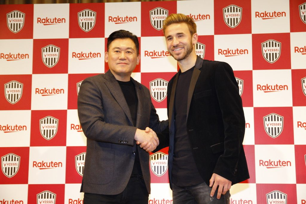 Rakuten CEO Mickey Mikitani with midfielder Sergi Samper at the press conference announcing his signing to the club