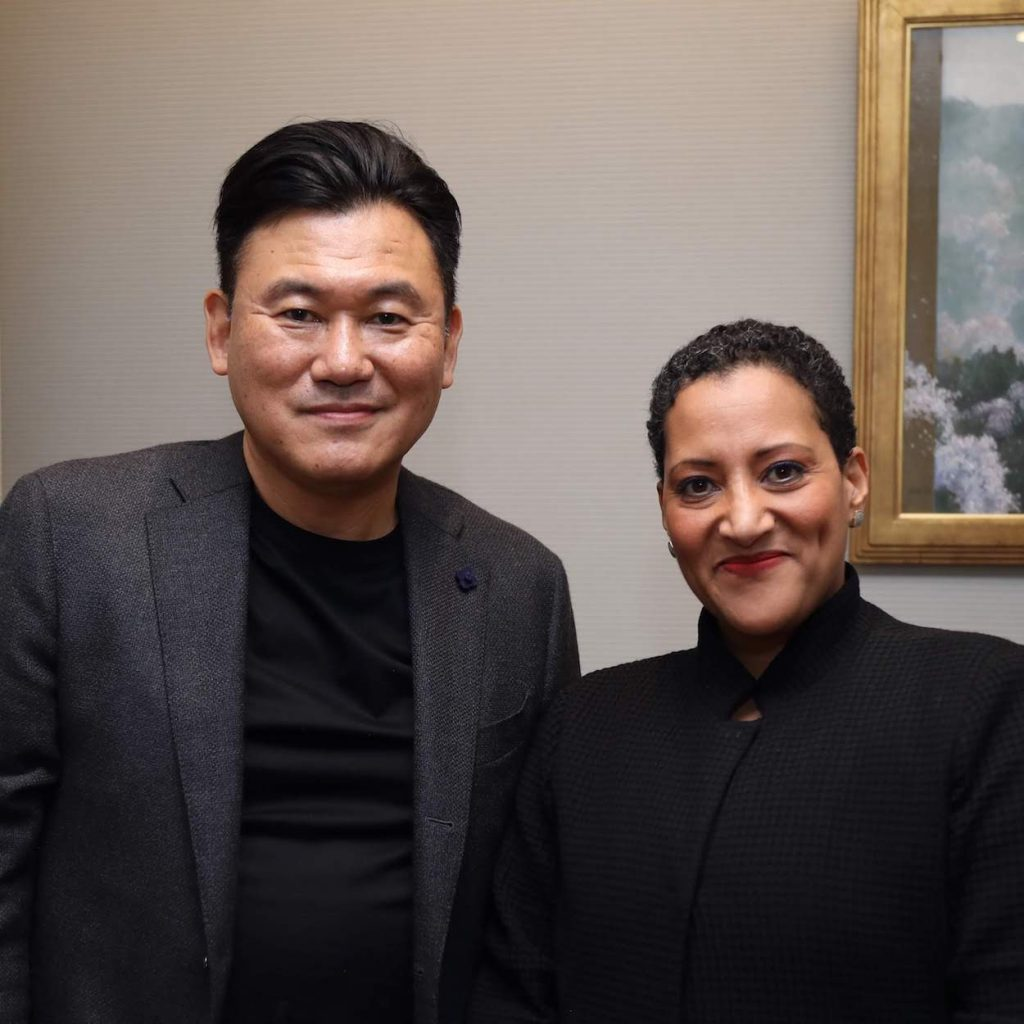 Mickey Mikitani (left) with Harvard Business School Professor Tsedal Neeley during a recent visit to Tokyo, where she spoke to Rakuten employees and highlighted the importance of securing buy-in when driving any large-scale transformative change within an organization.