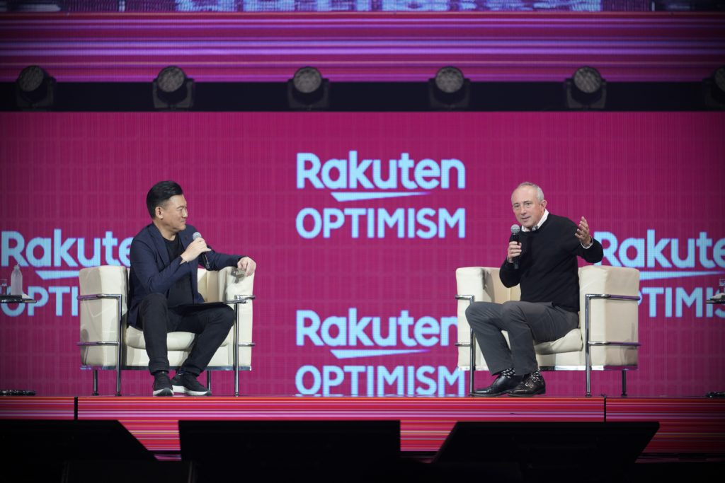 Agus (right) chats with Rakuten CEO Mickey Mikitani onstage.