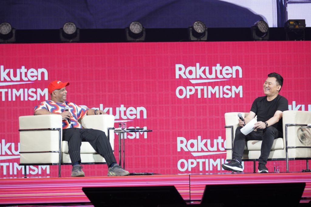 Longtime friends Tony Fernandes and Mickey Mikitani share a laugh on stage at Rakuten Optimism.