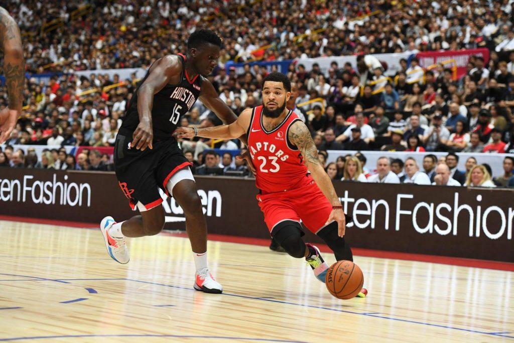 Raptors point guard Fred VanVleet maneuvers around Rockets center Clint Capela.