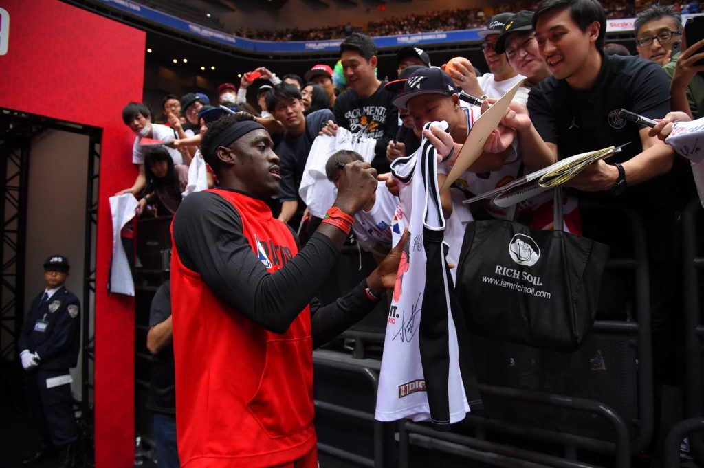 Pascal Siakam signing merch for lucky fans.